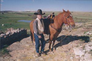 Bob Shultz with horse Gambler on Prairie Canyon Ranch